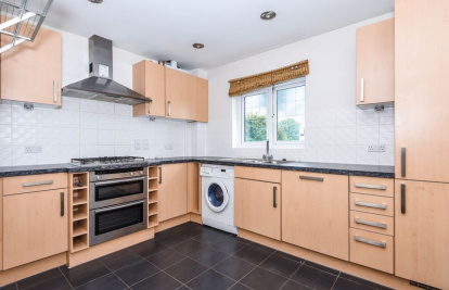 A two bedroom apartment with share of the freehold located close to 'The Nower', Dorking