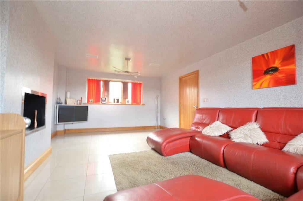 Property for sale in Morley, living room area, spacious, orange sofa