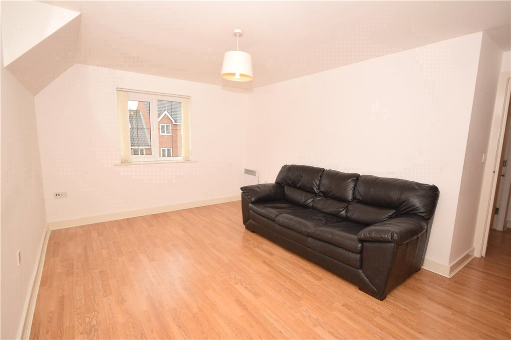 Property for sale in pudsey, empty living room brown sofa
