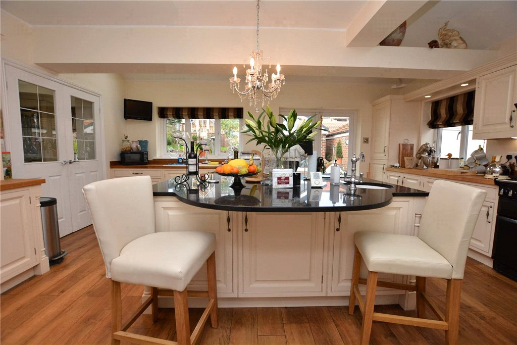 Property for sale in Pudsey, kitchen area. White modern fitted kitchen with island seating area