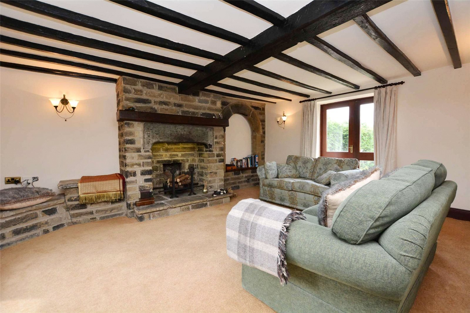 Property for sale in Wortley living room area, exposed beams and large open fire place