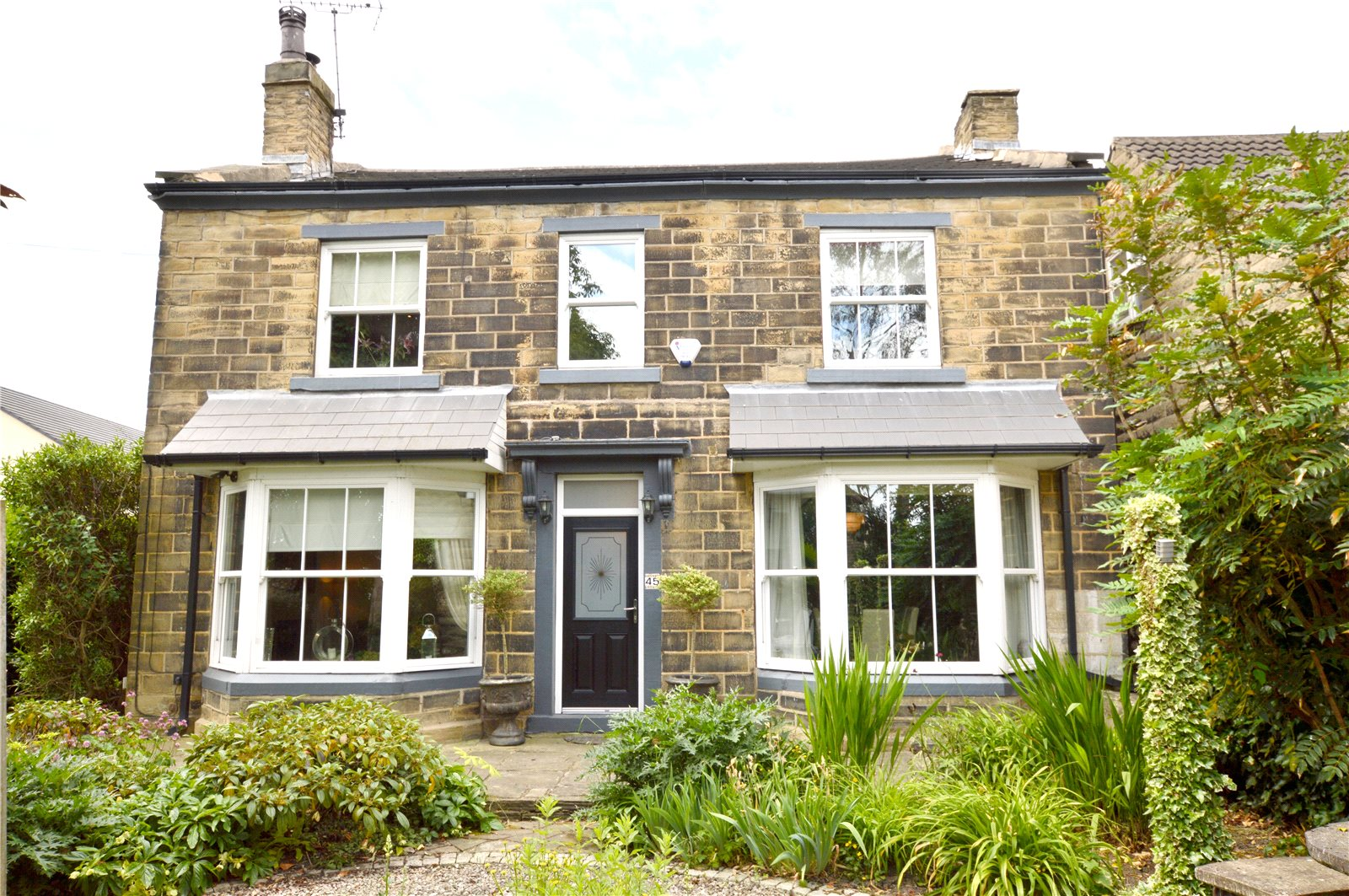 property for sale in Pudsey, exterior of period cottage