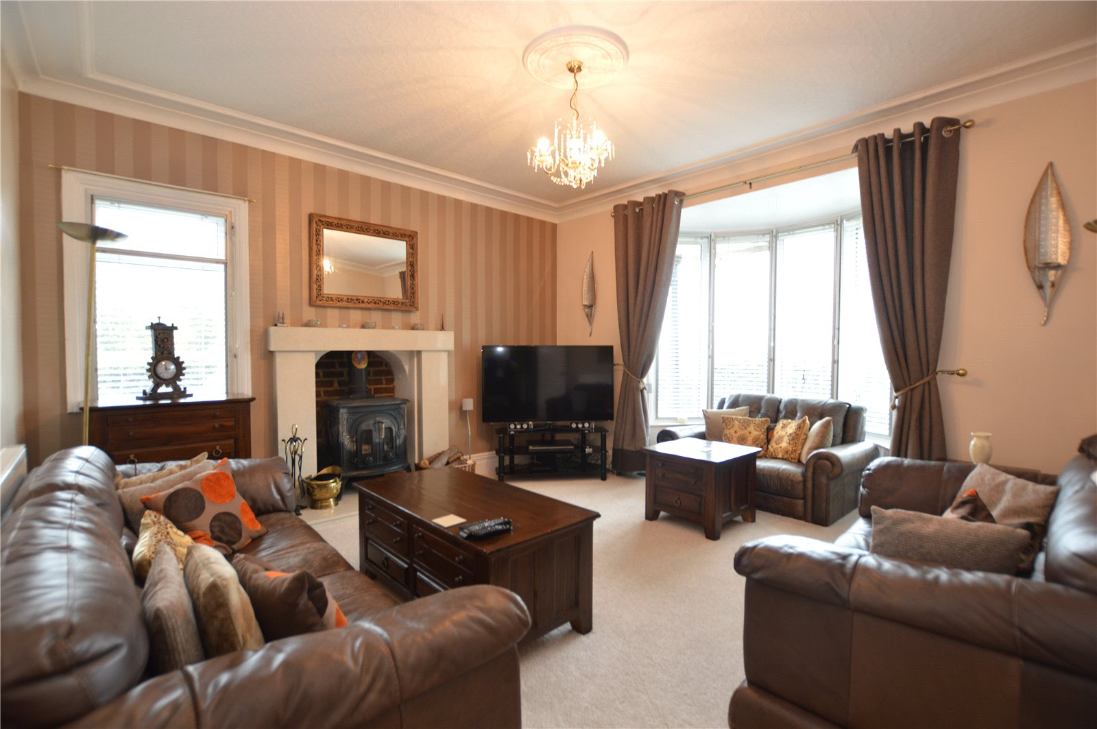 Property for sale in Morley, interior spacious family lounge, three leather sofas