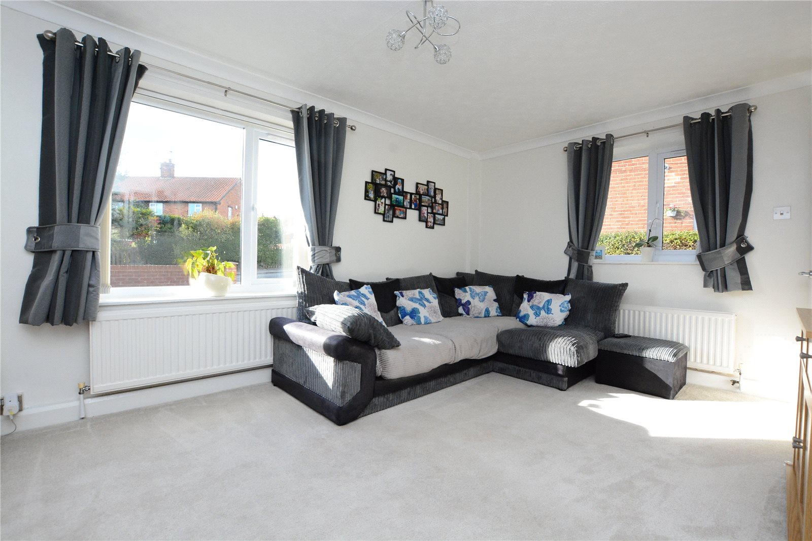 property for sale in Wetherby, interior of family lounge, grey corner sofa