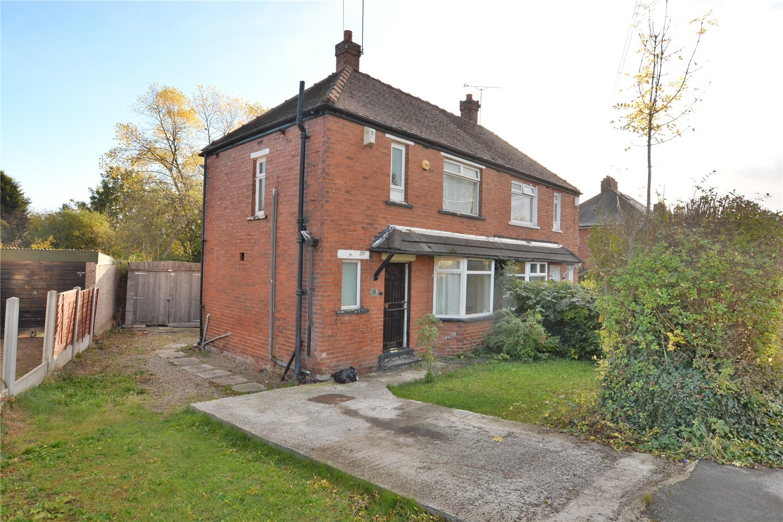 property for sale in Oakwood, exterior of red brick semi detached home