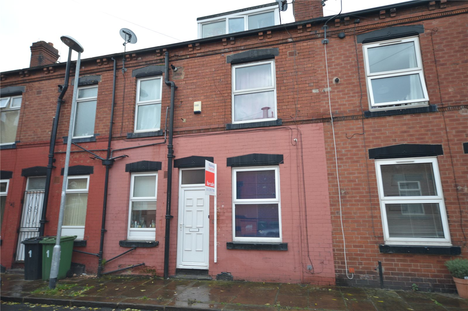 Property for sale in Beeston, exterior of terraced red brick home