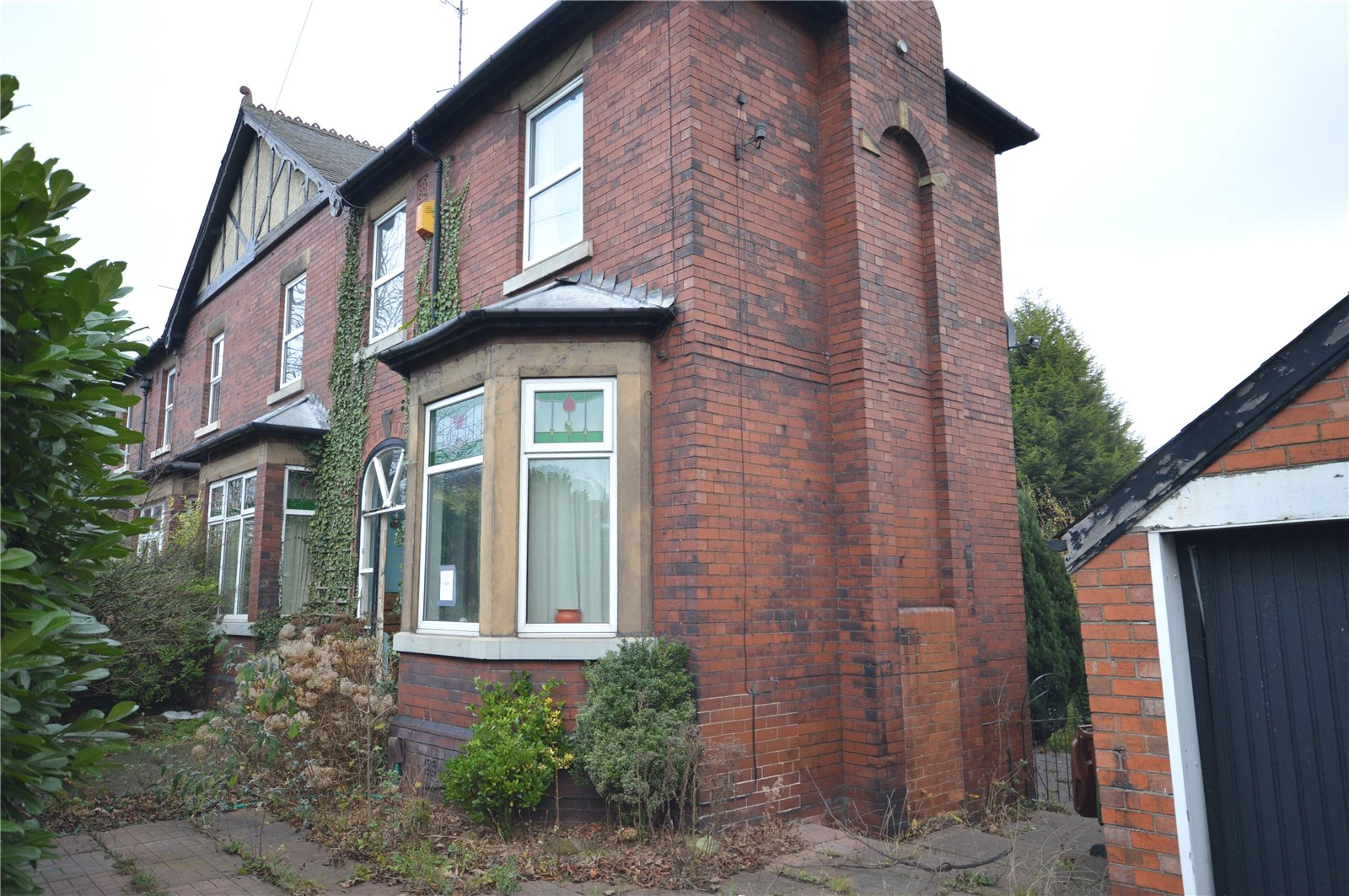 Property for sale in Sandal, exterior of semi detached red brick home