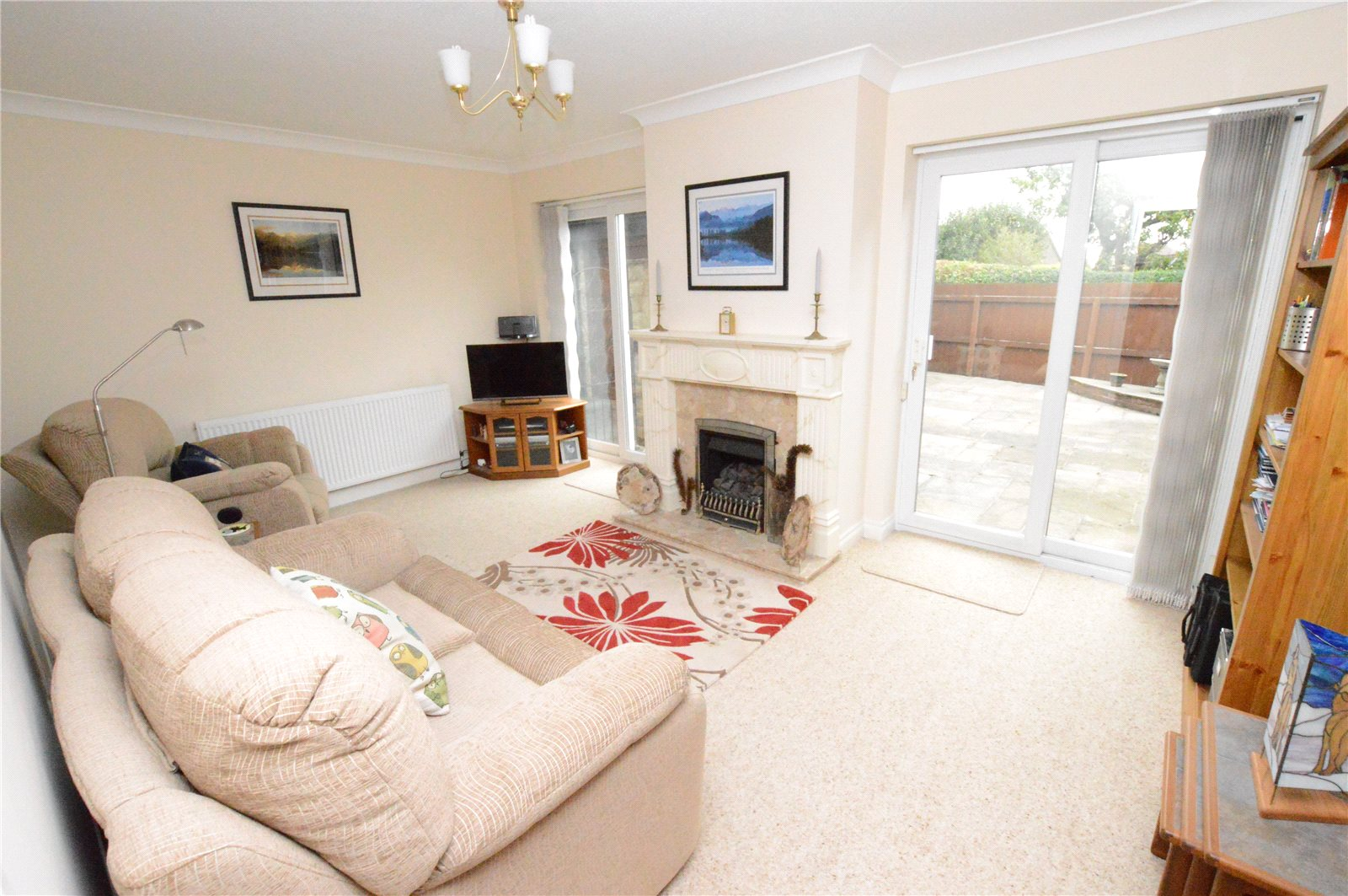 Property for sale in Crossgates, interior reception room two sofas and patio doors